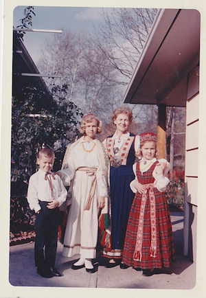 Figure 4: My Dad, his Two Sisters, and His Mother Dressed in Latvian Folk Outfits, Fall 1963